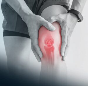 Bone in knee highlighted while gripped in pain